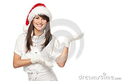 Santa girl pointing at copy space