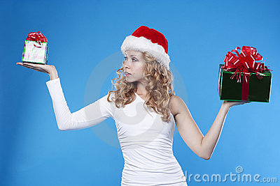 Santa girl with a present gift for New Year