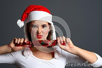 Santa girl pulling cracker
