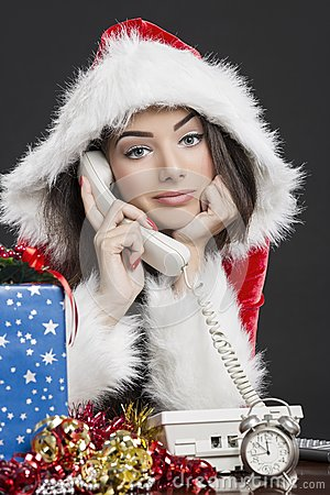 Santa girl talking on telephone
