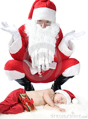 Santa is giving gift to sleeping baby