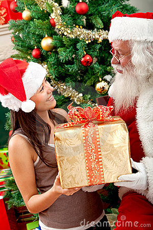 Santa giving a gift to a woman