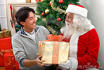 Santa giving a present to a man