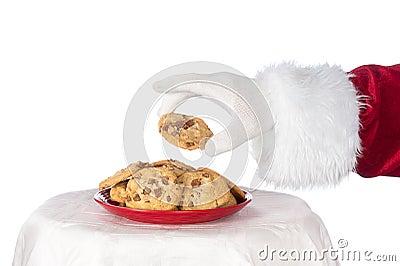 Santa grabbing cookie