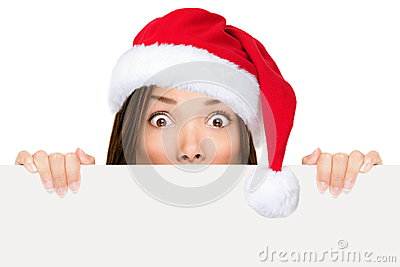 Santa hat woman showing christmas sign