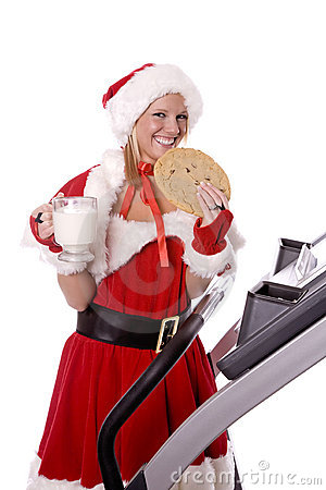 Santa helper with big cookie and milk on treadmill