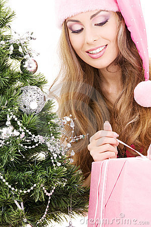 Santa helper girl with gift box and christmas tree