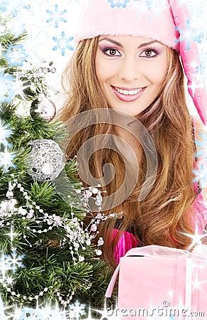 Santa helper girl with gift box and christmas tree