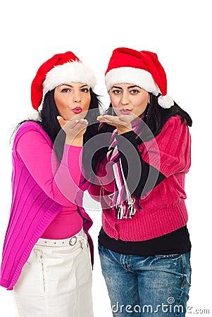 Santa helper women blow kisses