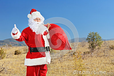 Santa hitchhiking on an open road