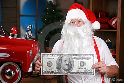 Santa holds a giant one hundred dollar bill