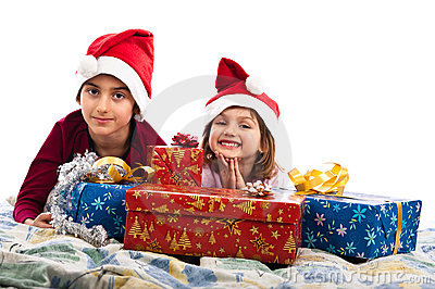 Santa kids in bed with Christmas presents