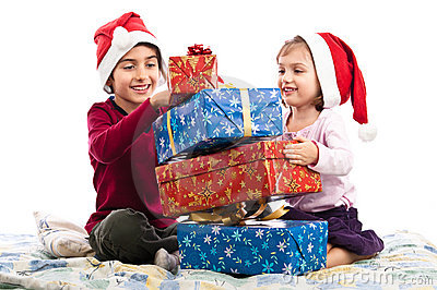 Santa kids enjoying Christmas presents