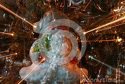 Abstract Santa Ornament on Christmas Tree with Light Rays Close Stock Photo