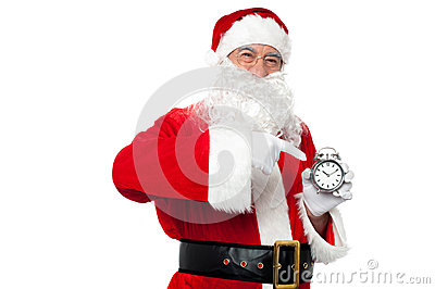 Santa pointing at an antique time piece