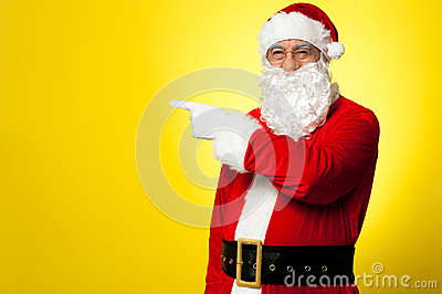 Santa pointing away towards something
