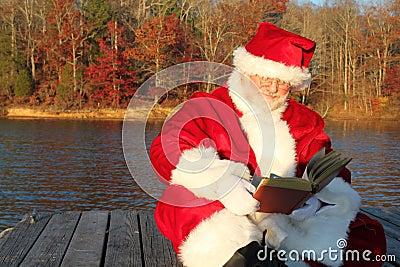 Santa Reading on the Dock