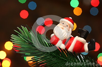 Santa resting over a christmas branch tree