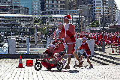 Santa s family on a run Editorial Image