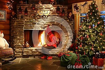 Santa s helper making fire