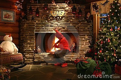 Santa's Helper Making Fire Royalty Free Stock Photo - Image: 1615585