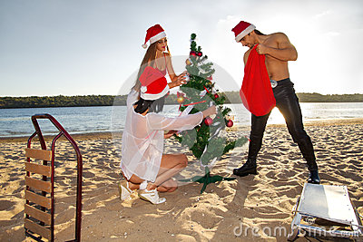 Santa s helper and Santa at the tropical beach