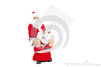 Santa seated on toilet and holding a blank banner