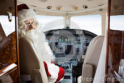 Santa Sitting In Cockpit Of Private Jet