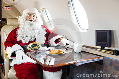 Santa Sleeping In Private Jet