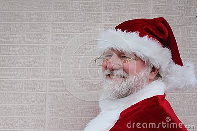 Santa Standing By A White Brick Wall