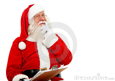 Santa thinking on the christmas list isolated on white.