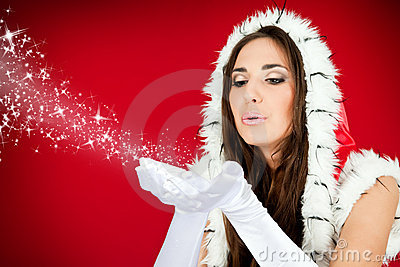 Santa woman blowing snow from her hands