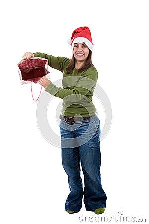 Santa woman celebrating christmas with present bag