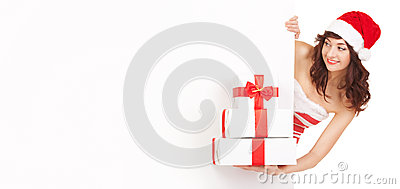 Santa woman with gift boxes looking at blank board