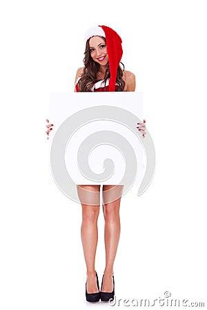 Santa woman presenting a blank board