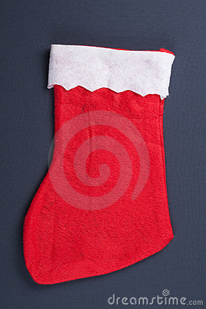 Santas red stocking over grey background