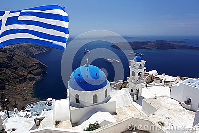 Santorini Church in Fira with flag of Greece