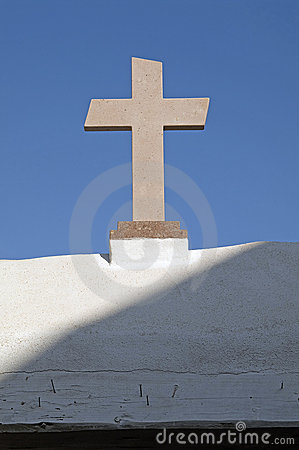 Stone cross and blue sky