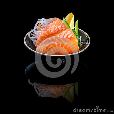 Free Sashimi With Salmon In A Black Plate. On A Black Background With Stock Photos - 81767643