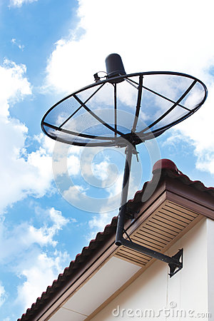 Satellite dish on house roof.