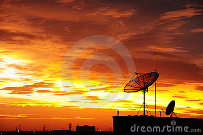 Satellite dish in the sunset