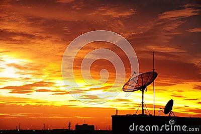 Satellite dish in the sunset