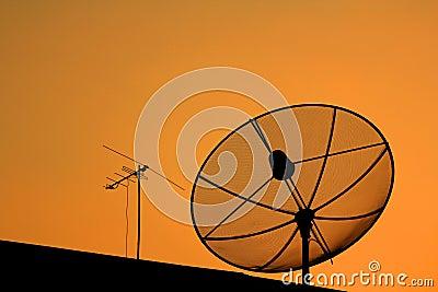Satellite dish in sunset