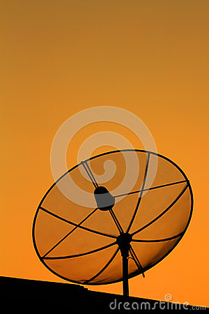 Satellite dish in sunset