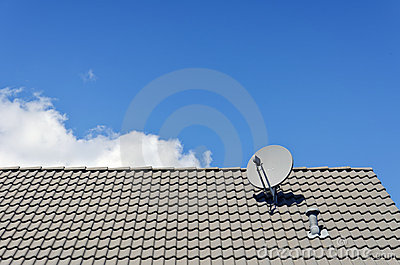 Satellite dish on tiled roof