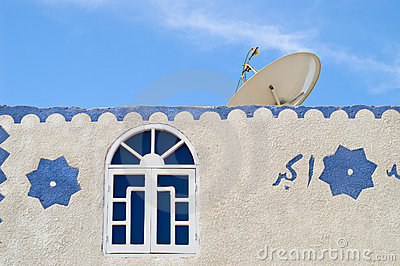 Satellite TV dish on muslim house