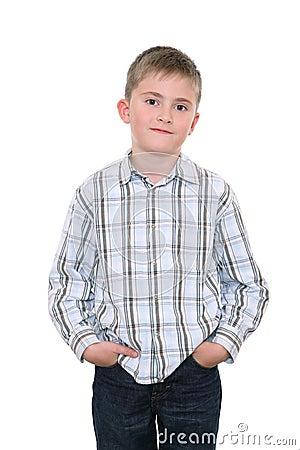 Satisfied boy keeps hands in pockets