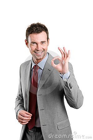 Satisfied business man showing okay sign