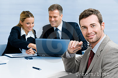 Satisfied businessman with colleagues