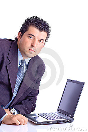 Satisfied businessman with a lap top computer